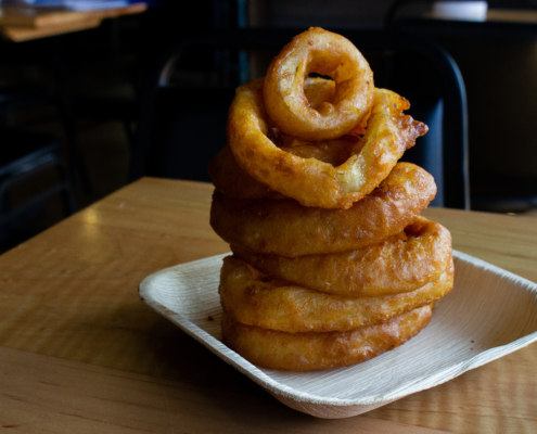 Backyard Market Onion Ring tower on a white plate